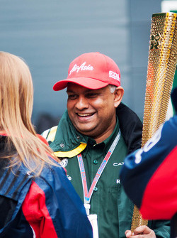 Tony Fernandes, Caterham Team Principal with the Olympic Torch
