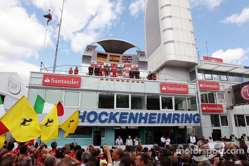 Podium: Sebastian Vettel, Red Bull Racing, second; Fernando Alonso, Ferrari, race winner; Jenson Button, McLaren, third