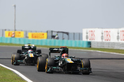 Heikki Kovalainen, Caterham leads Vitaly Petrov, Caterham