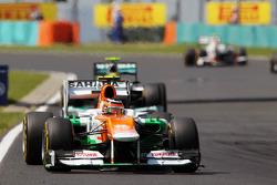 Nico Hulkenberg, Sahara Force India F1 leads Nico Rosberg, Mercedes AMG F1