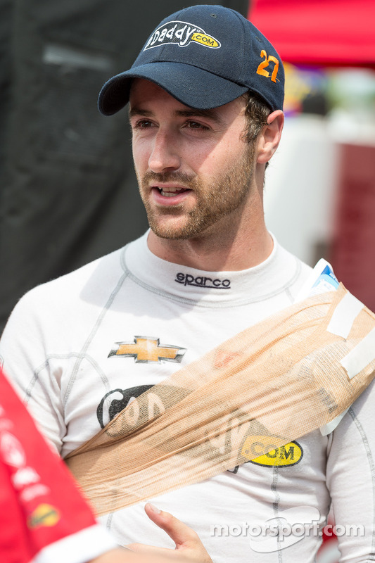 James Hinchcliffe shows the effects of a hard day's work