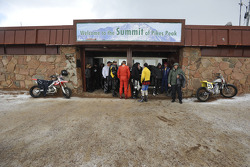 Riders and drivers at the summit under the snow