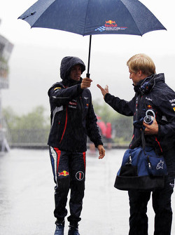 Sebastian Vettel, Red Bull Racing and Heikki Huovinen, Personal Trainer during a heavy rain shower