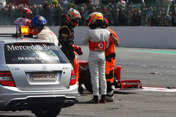 Romain Grosjean, Lotus F1 Team and Lewis Hamilton, McLaren talk after they were involved in a crash