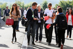 Jenson Button, McLaren signs autographs for the fans with Jessica Michibata