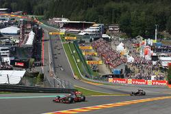 Jenson Button, McLaren Mercedes leads Kimi Raikkonen, Lotus F1 Team after the start
