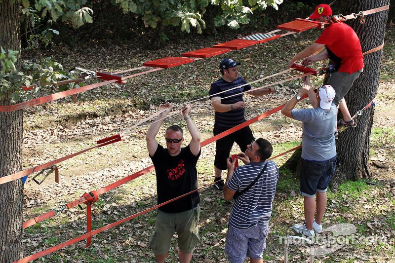 Fans construct a makeshift grandstand