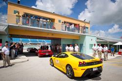 Customer lapping Ferrari cars head to track