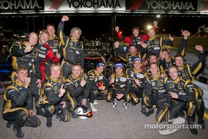 Neel Jani, Andrea Belicchi and Nicolas Prost celebrate with Rebellion Racing team members
