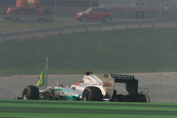 Michael Schumacher, Mercedes AMG F1 limps back to the pits with a puncture