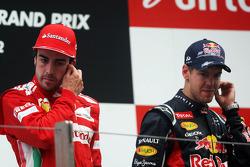 Fernando Alonso, Ferrari with race winner Sebastian Vettel, Red Bull Racing on the podium