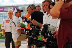 Kamui Kobayashi, Sauber and Annie Bradshaw, Sauber Press Officer with the media