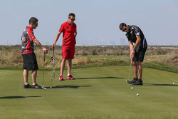 Michael Caruso, James Courtney and Rick Kelly take time out for a bit of golf at the Yas country club