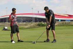 Michael Caruso and Rick Kelly take time out for a bit of golf at the Yas country club