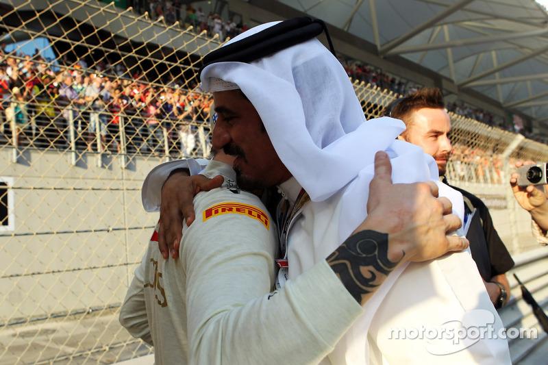Kimi Raikkonen, Lotus F1 Team met Mohammed Bin Sulayem, op de grid