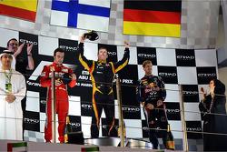 The podium: second place Fernando Alonso, Ferrari, race winner Kimi Raikkonen, Lotus F1 Team, third