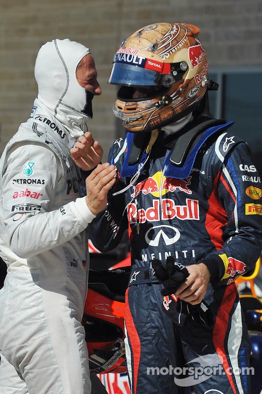 Polesitter Sebastian Vettel, Red Bull Racing celebrates with Michael Schumacher, Mercedes AMG F1