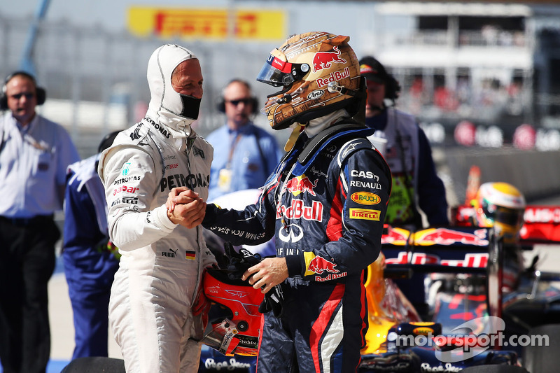Sebastian Vettel, Red Bull Racing celebrates his pole position in parc ferme with Michael Schumacher, Mercedes AMG F1
