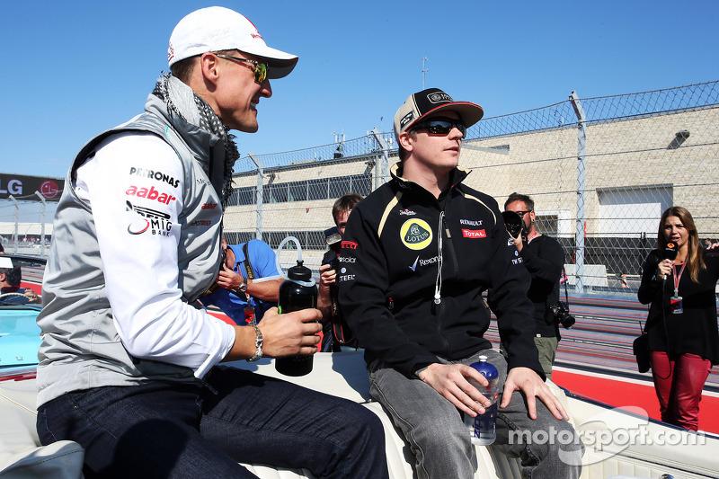 Michael Schumacher, Mercedes AMG F1 with Kimi Raikkonen, Lotus F1 Team on the drivers parade