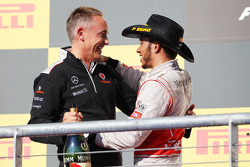 Race winner Lewis Hamilton, McLaren celebrates on the podium with Martin Whitmarsh, McLaren Chief Executive Officer