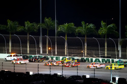 Pace truck leads Parker Kligerman, Red Horse Racing Toyota and Kyle Larson, Earnhardt Ganassi Racing Chevrolet during pace laps
