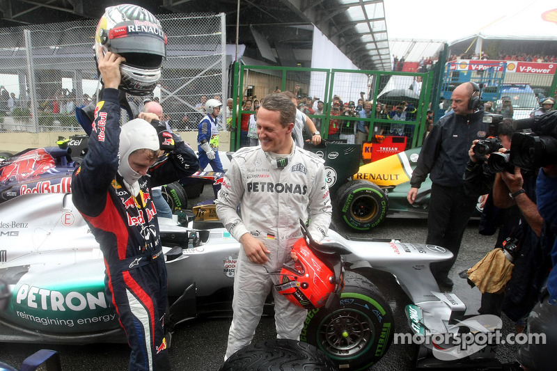 Sebastian Vettel, Red Bull Racing, e Michael Schumacher, Mercedes AMG F1