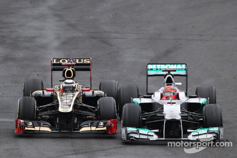 Michael Schumacher, Mercedes AMG F1, e Kimi Raikkonen, Lotus F1