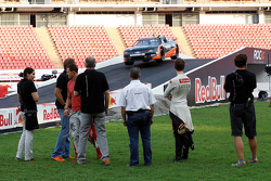 Michael Schumacher and Romain Grosjean watch practice