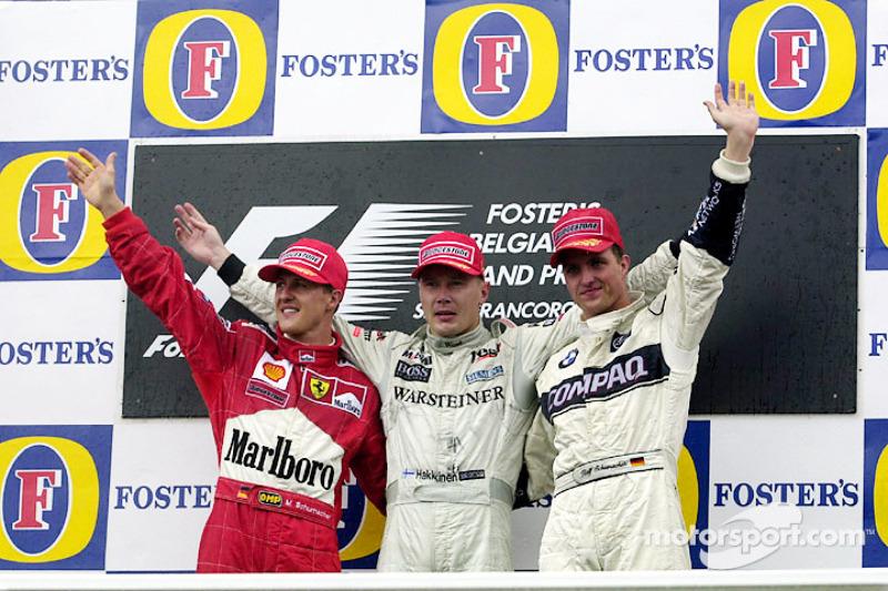Podium: race winner Mika Hakkinen, second place Michael Schumacher, third place Ralf Schumacher