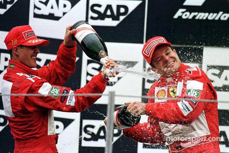 Михаэль Шумахер и Рубенс Баррикелло. ГП США, Воскресенье, после гонки.