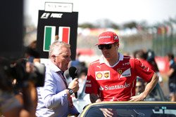 Kimi Raikkonen, Ferrari talks with Johnny Herbert, Sky TV on the drivers parade