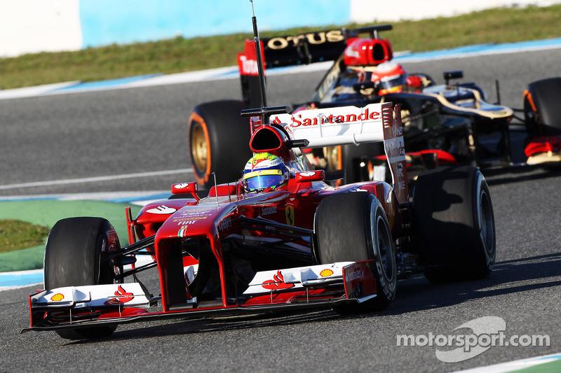 Felipe Massa, Ferrari leads Romain Grosjean, Lotus F1