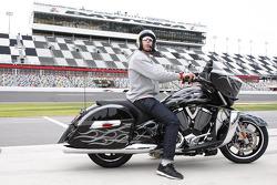 Travis Pastrana rides his motorcycle on Daytona International Speedway