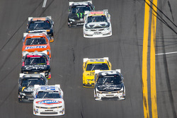 Kyle Larson and Brian Scott lead a group of cars