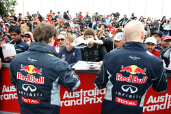 Christian Horner, Red Bull Racing Team Principal and Adrian Newey, Red Bull Racing Chief Technical Officer sign autographs for the fans