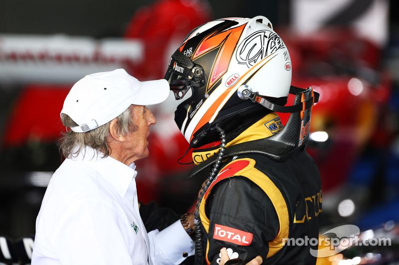 Race winner Kimi Raikkonen, Lotus F1 Team celebrates in parc ferme with Jackie Stewart (GBR)