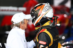 Race winner Kimi Raikkonen, Lotus F1 Team celebrates in parc ferme with Jackie Stewart (GBR)