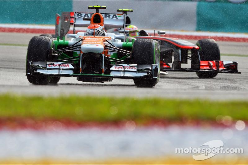 Adrian Sutil, Sahara Force India VJM06 voor Sergio Perez, McLaren MP4-28