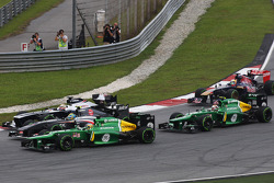 Giedo van der Garde, Caterham CT03 Esteban Gutierrez, Sauber C32 and Pastor Maldonado, Williams FW35 battle at the start of the race