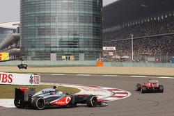 Fernando Alonso, Ferrari F138 leads Sergio Perez, McLaren MP4-28