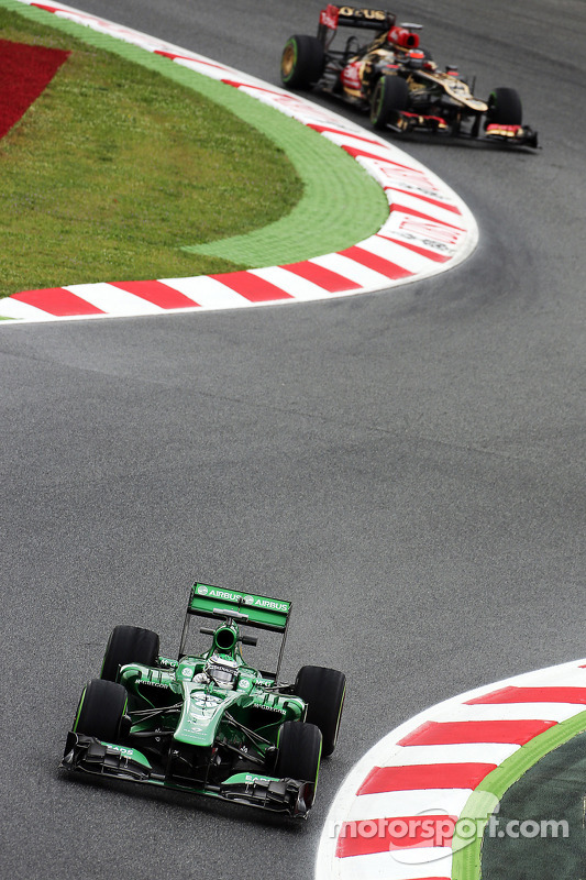 Heikki Kovalainen, Caterham  piloto reserva à frente de Kimi Raikkonen, Lotus F1