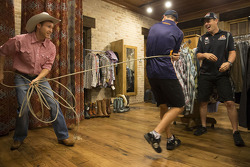 David Reynolds tries on some Texas style with Tim Slade and Craig Lowndes
