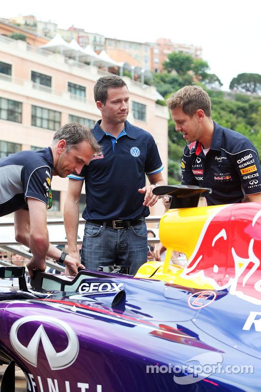 Sebastian Vettel, Red Bull Racing com Sébastien Ogier, piloto de rali