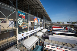 An overview of the Le Mans paddock with the Porsche banner advertising campaign