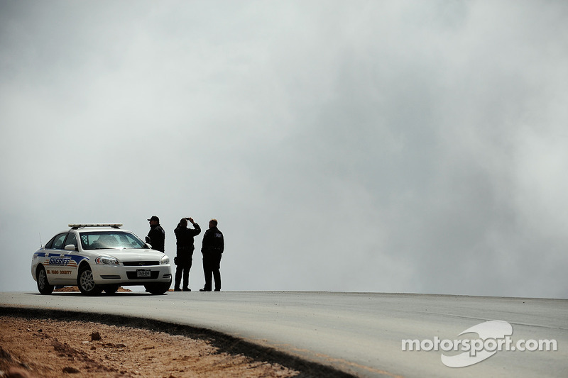 Officials check the changing weather conditions