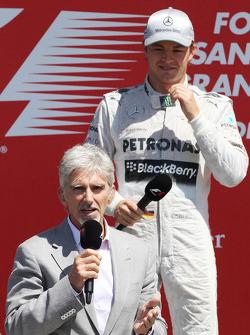 Race winner Nico Rosberg Mercedes AMG F1 with Damon Hill Sky Sports Presenter on the podium