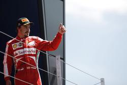 Fernando Alonso Ferrari celebrates his third position on the podium