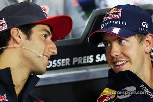 (L to R): Daniel Ricciardo, Scuderia Toro Rosso and Sebastian Vettel, Red Bull Racing in the FIA Press Conference