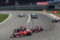 Fernando Alonso, Ferrari F138 leads Jenson Button, McLaren MP4-28 and Sergio Perez, McLaren MP4-28