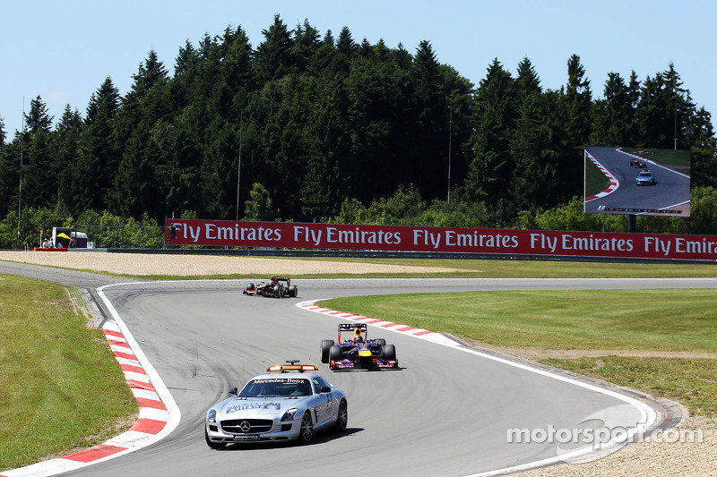 Sebastian Vettel, Red Bull Racing RB9 leads behind the Safety Car